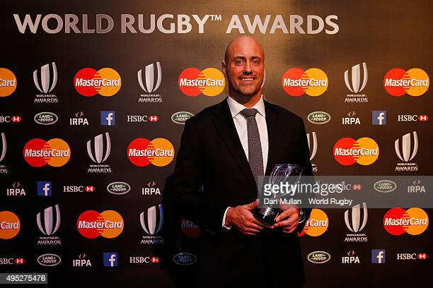 Former Australia player Nathan Sharpe poses after receiving the IRPA Special Merit award during the World Rugby Awards 2015 at Battersea Evolution on...