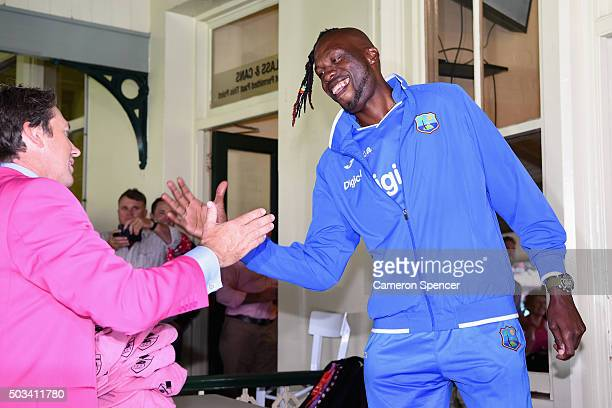 Former Australian bowler Glenn McGrath embraces fomer West Indies bowler and West Indies Bowling Coach Curtley Ambrose on Jane McGrath Day during day...