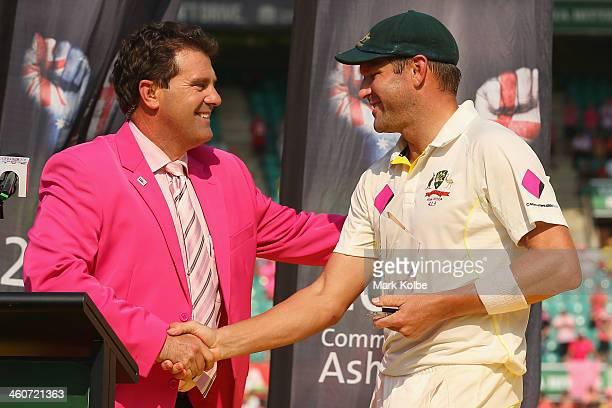 Former Australian captain Mark Taylor shakes hands with Ryan Harris of Australia after he received the Player of the Match during day three of the...