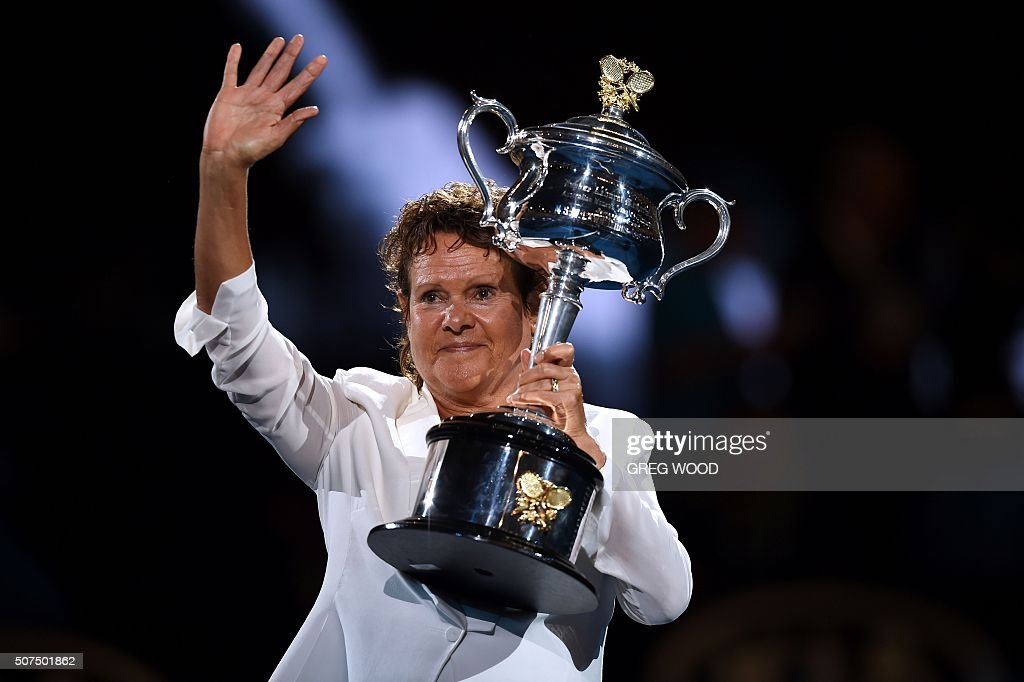 Former Australian champion Evonne Goolagong Cawley poses with The Daphne Akhurst Memorial Cup ahead of the women's singles final match between Serena Williams of the US and Germany's Angelique Kerber on day thirteen of the 2016 Australian Open tennis tournament in Melbourne on January 30, 2016.