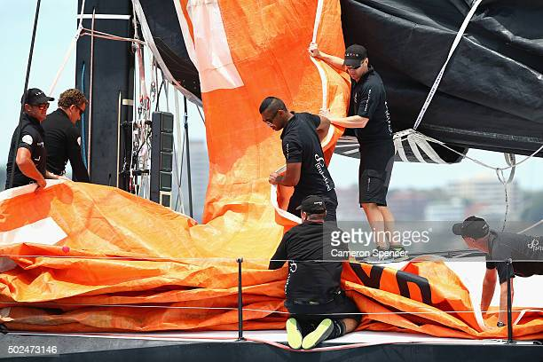 Former Australian cricket captain Michael Clarke and Australian Wallaby rugby player Kurtley Beale work onboard Supermaxi Perpetual Loyal during the...