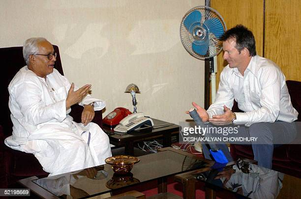 Former Australian cricket captain Steve Waugh speaks with the Chief Minister of the Indian state of West Bengal Buddhadev Bhattacharya, in Calcutta,...