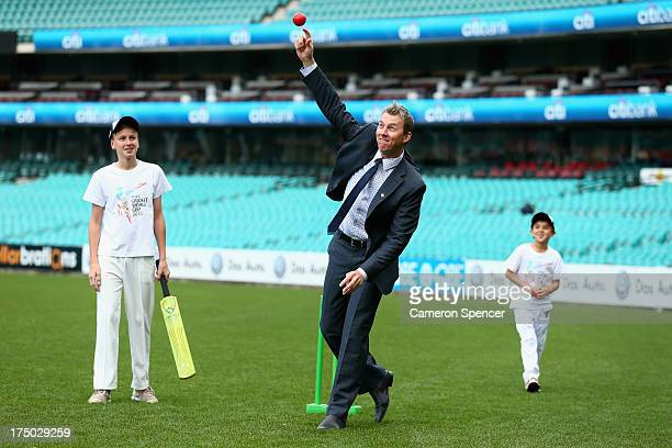 Former Australian cricket player, Brett Lee bowls to young players during the announcement of the NSW venues for the 2015 ICC Cricket World Cup at...