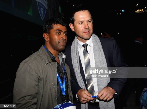 Former Australian Cricket player Ricky Ponting poses for photos with a fan during the 2013 Blackwoods North Melbourne Grand Final Breakfast at Etihad...