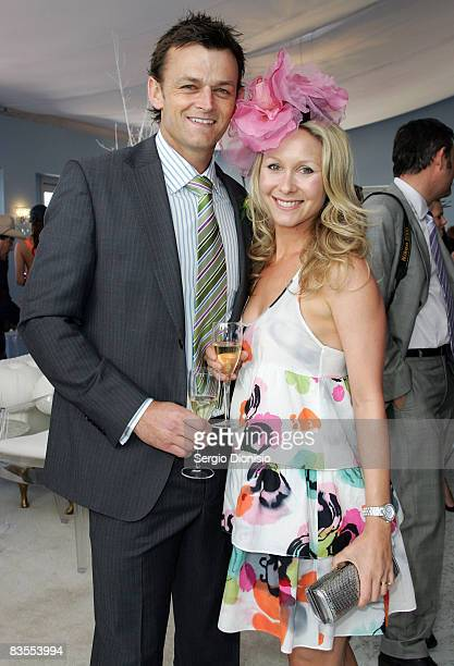 Former Australian cricketer Adam Gilchrist and his wife Mel pose in the Emirates Marquee during Emirates Melbourne Cup Carnival 2008 at Flemington...