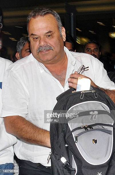Former Australian cricketer Dav Whatmore leaves the Allama Iqbal International airport upon his arrival in Lahore on March 2 2012 Pakistan is likely...