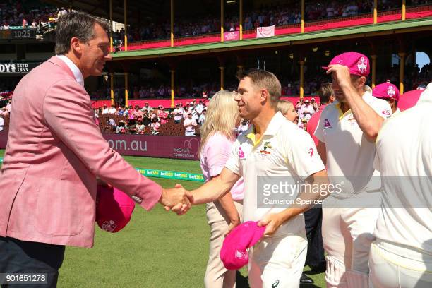 Former Australian cricketer Glenn McGrath shakes hands with David Warner of Australia on Jane McGrath Day during day three of the Fifth Test match in...