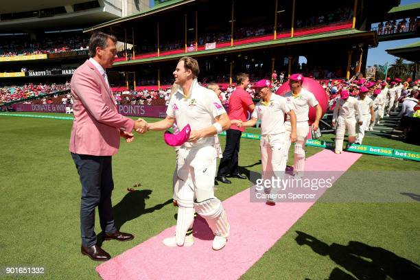 Former Australian cricketer Glenn McGrath shakes hands with Steve Smith of Australia on Jane McGrath Day during day three of the Fifth Test match in...