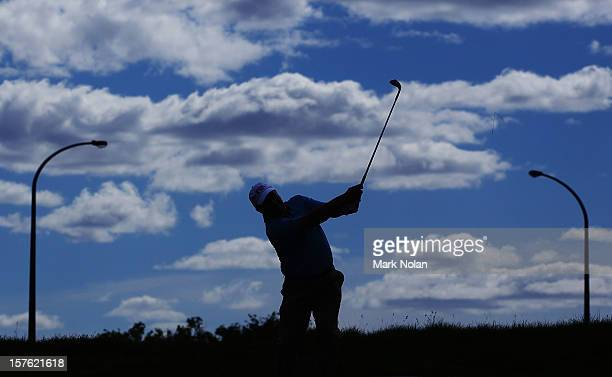 Former Australian cricketer Ian Healy hits out of the rough during the ProAm ahead of the 2012 Australian Open beginning tomorrow at The Lakes Golf...