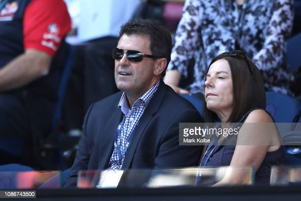 Former Australian cricketer Mark Taylor watches the quarter final match against Milos Raonic of Canada and Lucas Pouille of France during day 10 of...