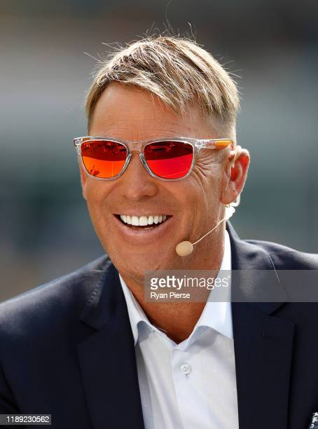 Former Australian Cricketer Shane Warne commentates for Fox Cricket during day two of the 1st Domain Test between Australia and Pakistan at The Gabba...
