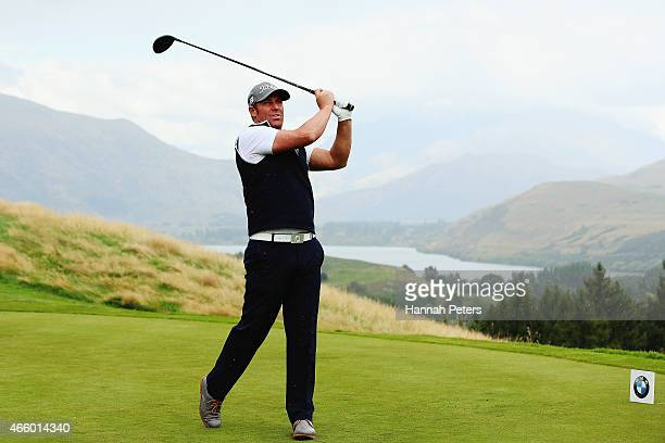 Former Australian cricketer Shane Warne tees off during day two of the New Zealand Open at The Hills Golf Club on March 13 2015 in Queenstown New...