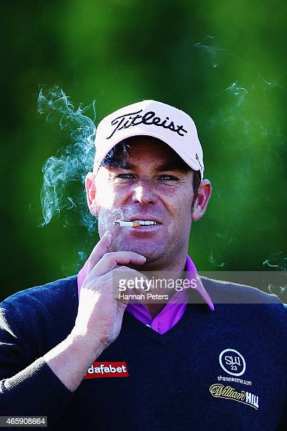 Former Australian cricketer Shane Warne walks to to the green during day one of the New Zealand Open at The Hills Golf Club on March 12 2015 in...
