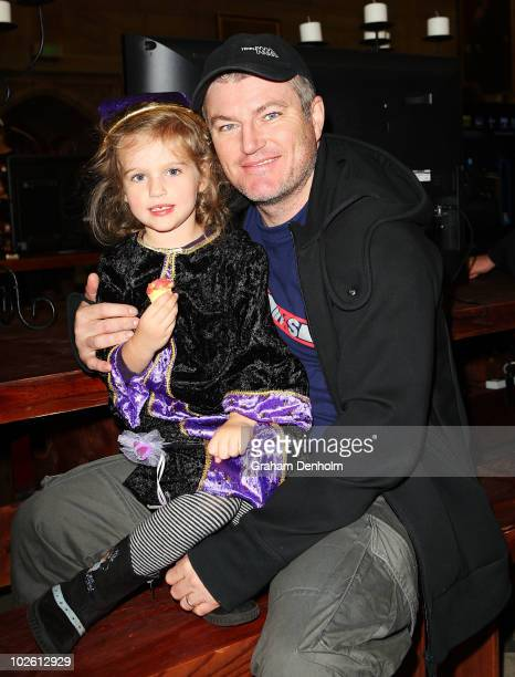 Former Australian cricketer Stuart MacGill and daughter Penny attend the LEGO Harry Potter Open Day at Sydney University on July 4 2010 in Sydney...