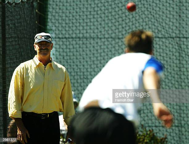 Former Australian fast bowling great Dennis Lillee works with Nathan Bracken of Australia during training at the WACA on October 5 2003 in Perth...