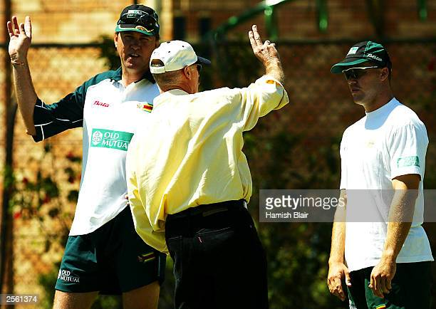Former Australian fast bowlng great Dennis Lillee speaks to Heath Streak of Zimbabwe and bowling coach Bruce Reid during training at the WACA on...