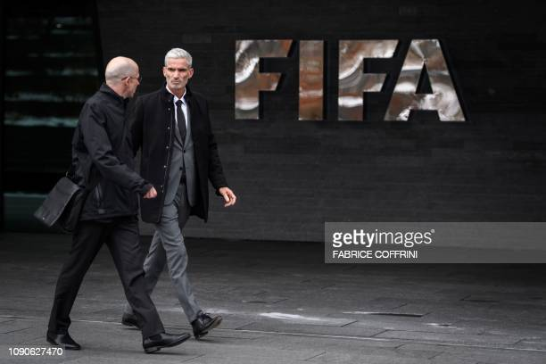 Former Australian football player Craig Foster leaves the FIFA headquarters in Zurich next to Executive Director of the World Players Association...