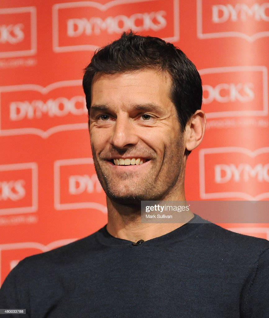 Former Australian Formula One driver Mark Webber signs his autobiography 'Aussie Grit' at Sofitel Hotel on July 9, 2015 in Sydney, Australia. Webber, who won the Monaco Grand Prix twice during his 11-year career, now drives in the Porsche Le Mans.