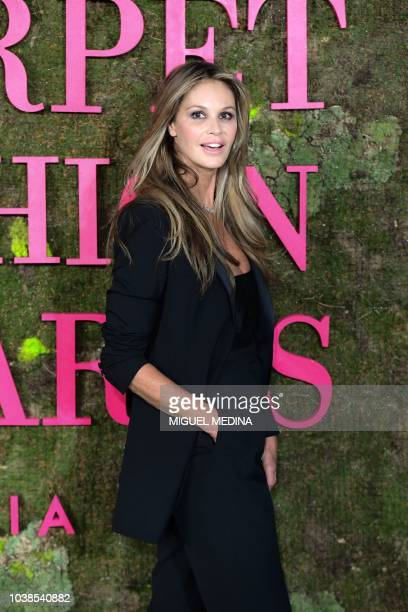 Former Australian moder Elle Macpherson poses as she arrives to attend the Green Carpet Fashion Awards 2018 within the Women's Spring/Summer 2019...