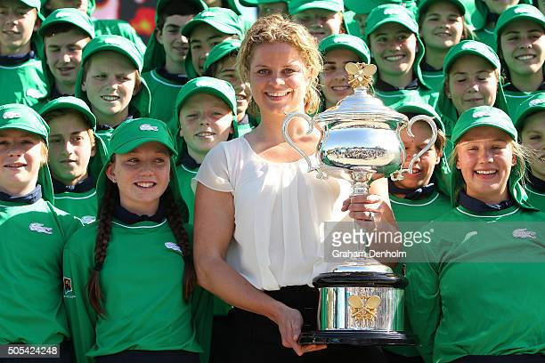 Former Australian Open Champion Kim Clijsters of Belgium poses with Daphne Akhurst Memorial Cup and 2016 ballkids during day one of the 2016...