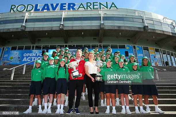 Former Australian Open Champions Boris Becker of Germany and Kim Clijsters of Belgium pose with Daphne Akhurst Memorial Cup and Norman Brookes...