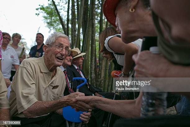 Former Australian POW Walter Holding greets people after the sunrise memorial service in remembrance of all those who lost their lives April 25, 2013...