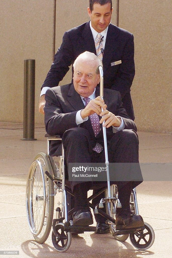 Former Australian Prime Minister Gough Whitlam arrives at the Sydney Opera House on March 13, 2006 in Sydney, Australia. The Queen and Prince Philip are on a five-day visit to Australia where she will officially open the Commonwealth Games in Melbourne.