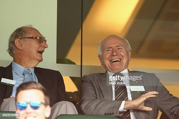 Former Australian Prime Minister John Howard laughs as he watches on during day two of the Third Test match between Australia and Pakistan at Sydney...
