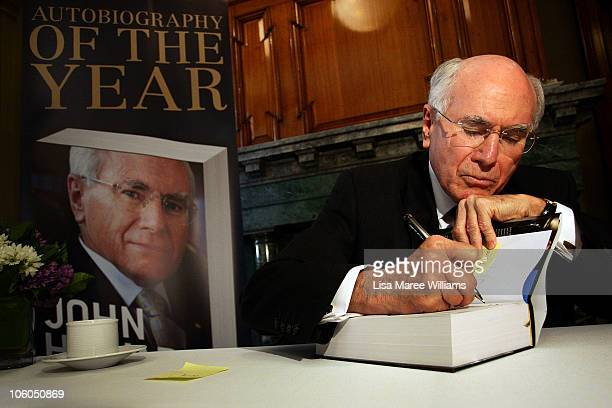 Former Australian Prime Minister John Howard signs his autobiography titled 'Lazarus Rising' on October 26 2010 in Sydney Australia Lazarus Rising A...