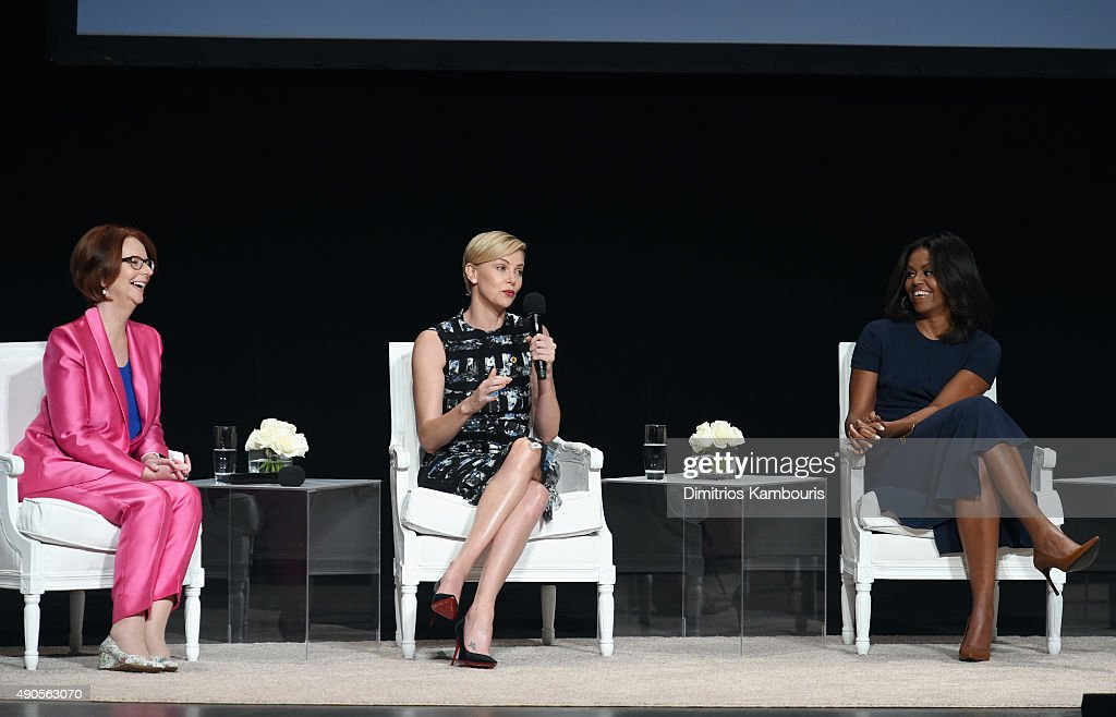Former Australian Prime Minister Julia Gillard, Founder of Charlize Theron Africa Outreach Project and U.N. Messenger of Peace Charlize Theron and First Lady of the United States Michelle Obama join Glamour 'The Power Of An Educated Girl' panel at The Apollo Theater on September 29, 2015 in New York City.