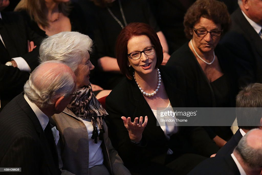 Former Australian Prime Minister, Julia Gillard speaks with former Australian Prime Minister, Malcolm Fraser at the state memorial service for former Australian Prime Minister Gough Whitlam at Sydney Town Hall on November 5, 2014 in Sydney, Australia. Gough Whitlam was the 21st Prime Minister of Australia. He died on October 21, aged 98.