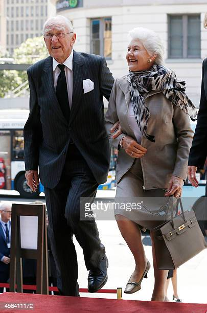 Former Australian Prime Minister Malcolm Fraser arrives with his wife Tamie at the state memorial service for former Australian Prime Minister Gough...