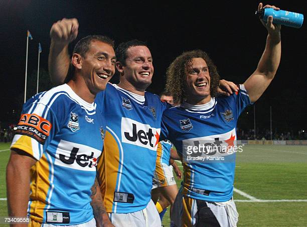 Former Australian Rugby Union International Mat Rogers with his Titan team mates Chris Walker and Matt Petersen celebrate victory after the NRL trial...