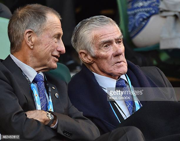 Former Australian tennis champion Ken Rosewall looks on as Britain's Andy Murray plays a shot during his men's singles semifinal match against Czech...