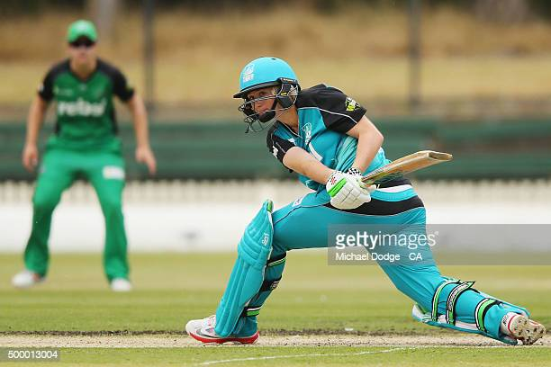 Former Australian tennis player Ash Barty of the Heat hits the ball during the Women's Big Bash League match between the Brisbane Heat and the...