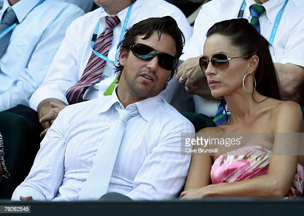 Former Australian tennis player Pat Rafter and his wife Lara Feltham watch the women's final match between Maria Sharapova of Russia and Ana Ivanovic...