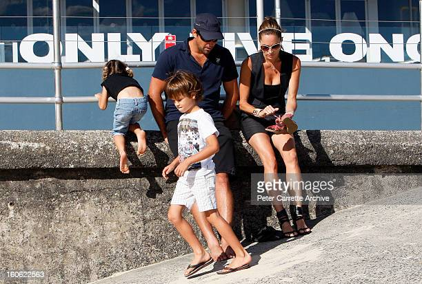 Former Australian tennis player Pat Rafter with his wife Lara Rafter and their children Josh and India at Bondi Beach on January 17 2010 in Sydney...