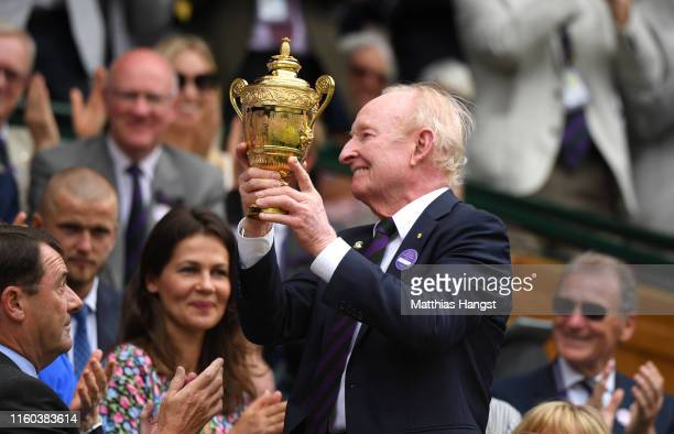 Former Australian tennis player Rod Laver is handed the Men's singles trophy from The Royal Box on centre court during Day six of The Championships...