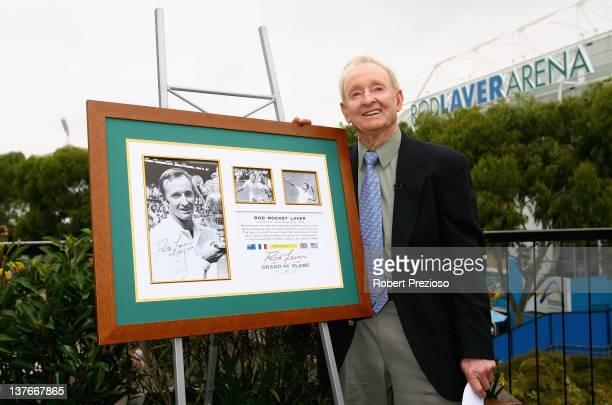 Former Australian tennis player Rod Laver poses with a memorabilia piece to mark the fiftieth anniversary of his first Grand Slam during day ten of...