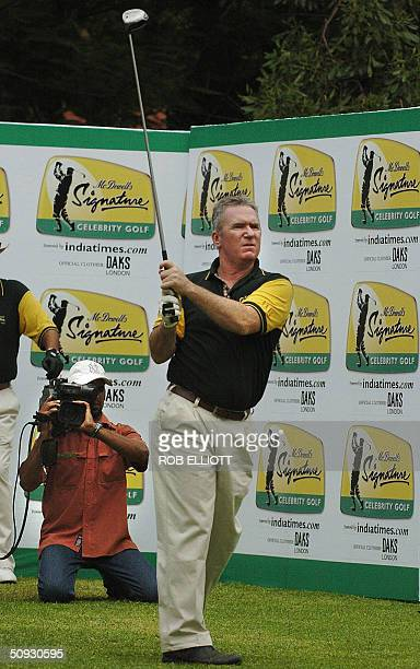 Former Australian Test cricketer Allan Border drives off the first tee in the McDowell's Signature Celebrity Golf tournament at the US Golf Club in...