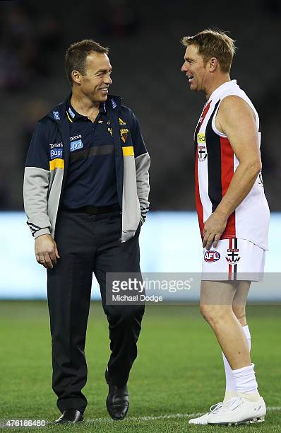 Former Australian Test cricketer and Saints fan Shane Warne meets Hawks head coach Alastair Clarkson when playing a Saints corporate game before the...