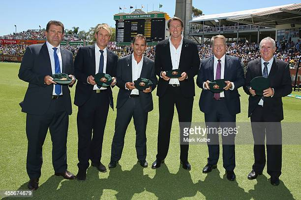 Former Australian test cricketers Mark Taylor Shane Warne Justin Langer Glenn McGrath Ian Healy and Allan Border pose with caps comemorating playing...