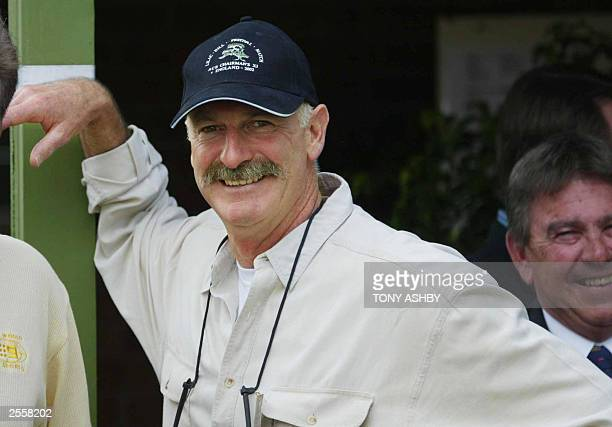 Former Australian test great fast bowler Dennis Lillee watches the match between Zimbabwe and an Australian Cricket Board Chairman's X1 at Lilac Hill...