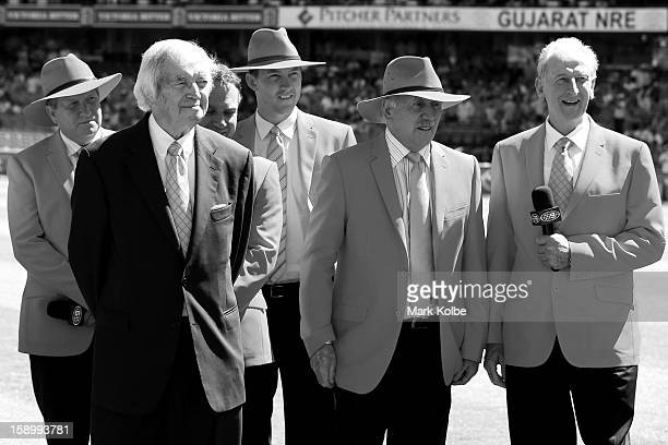 Former Australian test players and current Channel 9 commentators Ian Healy Richie Benaud Michael Slater Brett Lee Ian Chappell and Bill Lawry watch...