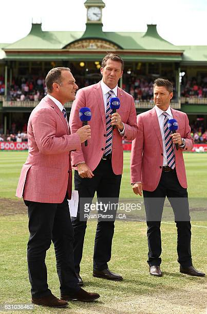 Former Australian Test players Michael Slater Glenn McGrath and Michael Clarke wear pink while commentating on Nine on Jane McGrath Day during day...