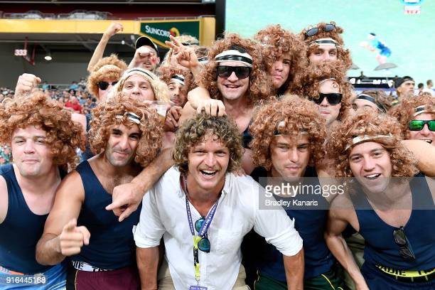 Former Australian Wallabies player Nick Cummins poses for a photo with a group of his fans during the 2018 Global Tens at Suncorp Stadium on February...