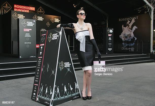 Former Australia's Next Top Model winner Demelza Reveley madeup to look like screen star Audrey Hepburn poses to celebrate Hepburn's 80th birthday...