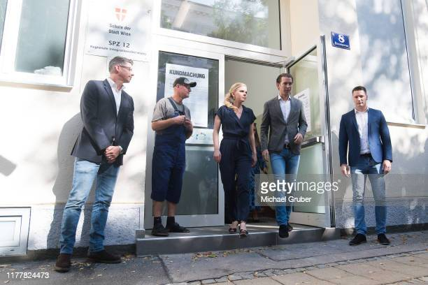 Former Austrian Chancellor and leader of the Austrian People's Party Sebastian Kurz leaves with his girlfriend Susanne Thier a polling station after...