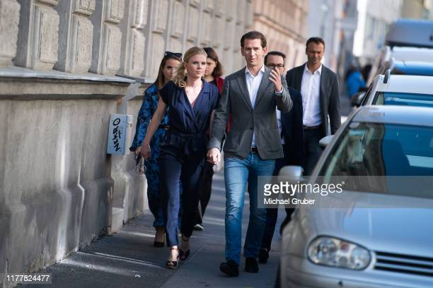 Former Austrian Chancellor and leader of the Austrian People's Party Sebastian Kurz arrives with his girlfriend Susanne Thier at a polling station to...