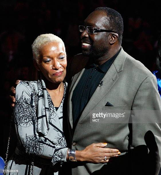 Former Baltimore Bullet Earl The Pearl Monroe with wife Marita Green addresses the crowd during a ceremony to retire his jersey during halftime of...